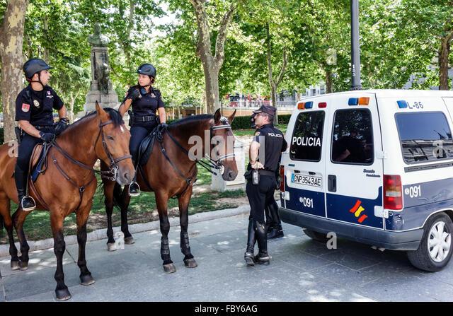 Madrid Spain Europe Spanish Hispanic Centro Plaza de Oriente Palacio Real de Madrid Royal Palace policia police - Stock Image