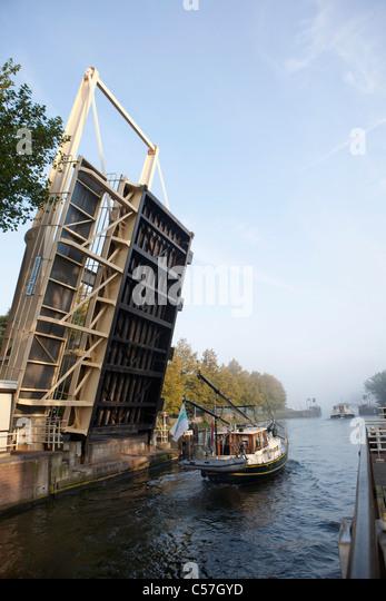 The Netherlands, Nigtevecht, Shipson canal called Amsterdam Rijn Kanaal. Bridge. - Stock Image