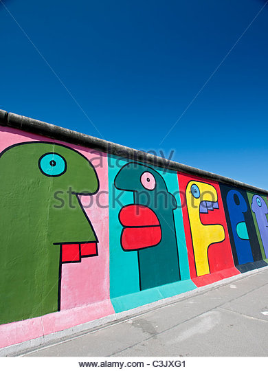 Murals painted on original section  of Berlin Wall at East Side Gallery in Friedrichshain Berlin Germany - Stock Image