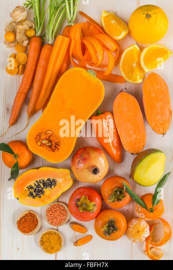 Orange coloured fruit and vegetables - Stock Image