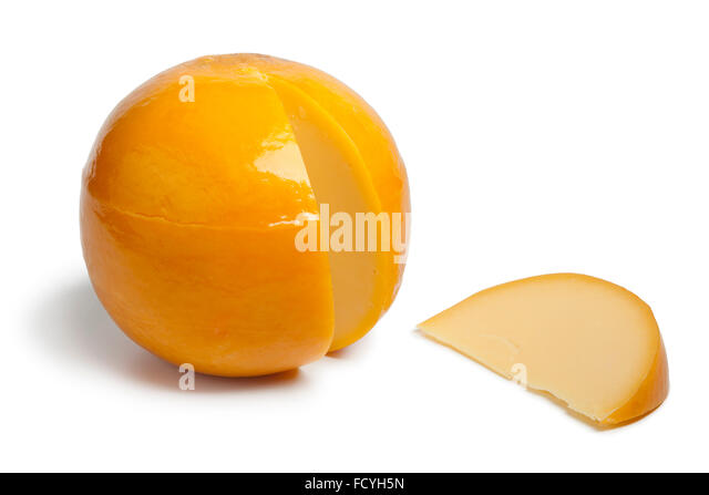 Whole yellow round Edam cheese with a slice on white background - Stock Image