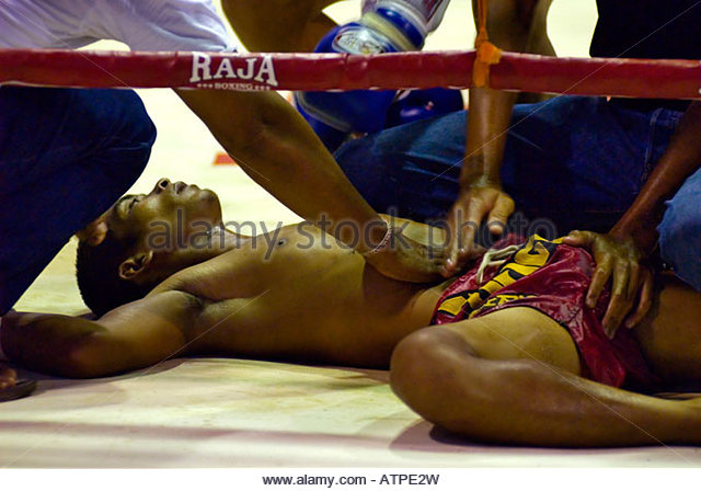 Knocked out MuayThai Boxer during a fight in Krabi - Stock Image