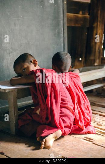 Novice monks studying at monastery near Mandalay Burma Myanmar - Stock-Bilder
