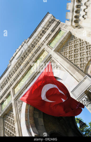 The national flag flies under the entrance to Istanbul University, Beyazıt Square, Istanbul, Turkey - Stock Image