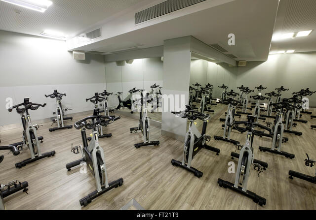 Spin bikes stock photos images alamy