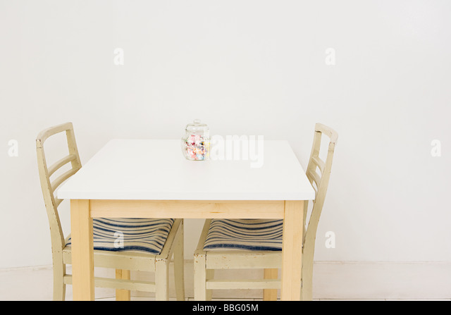 Jar of sweets on a table - Stock Image