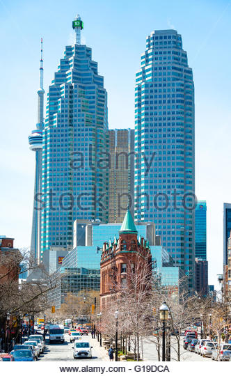 Old Town Toronto contrasting with modern downtown skyscrapers.  The flatiron or Gooderham building contrasts with - Stock Image