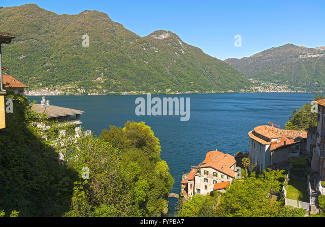 Landscape on the Como Lake in a clear morning of spring season - Stock Image