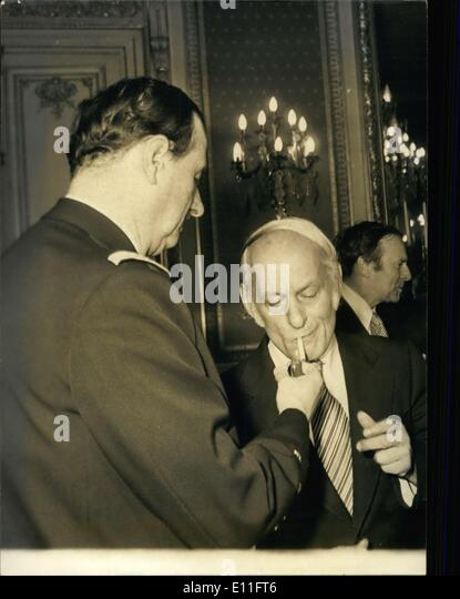 Nov. 03, 1977 - Admiral Philippe de Gaulle lights Rene Levesque's (the Prime Minister of Canada) cigarette during - Stock Image