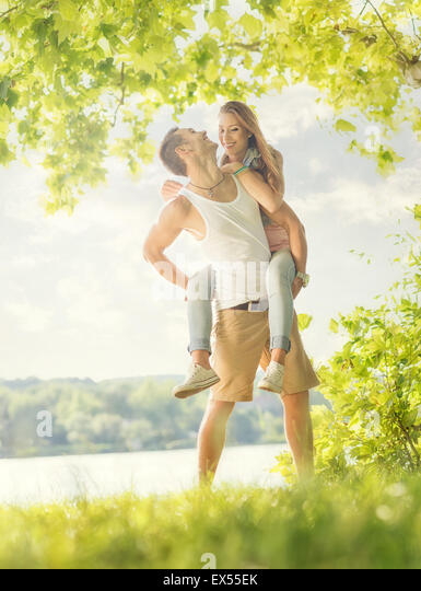 Couple in love on the lake, hug - Stock-Bilder
