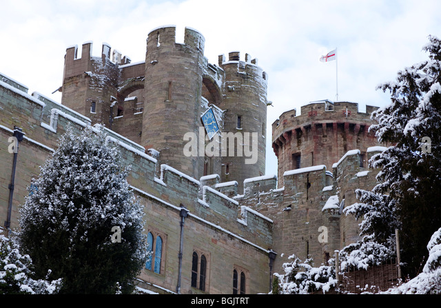 Warwick Castle covered in a dusting of snow - Stock Image