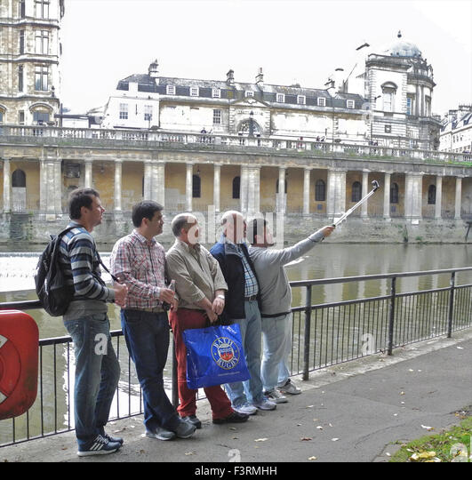 The Georgian city of Bath attracts numbers of foreign visitors or tourists who take endless photographs to record - Stock Image