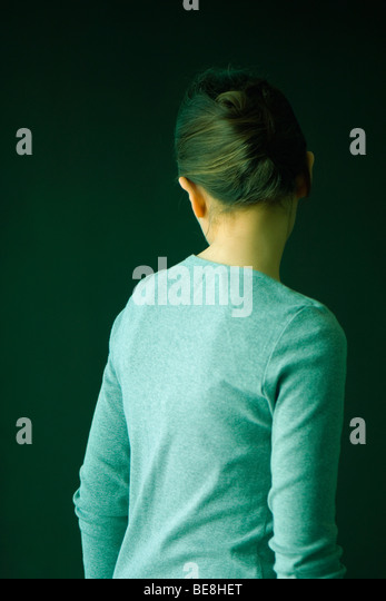Young woman turning away from camera - Stock Image