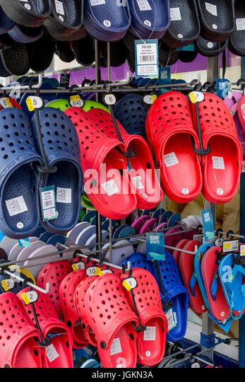 Display of beach footwear for sale in the seaside town of Newquay, Cornwall. UK. - Stock Image