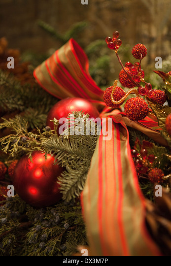 Green and red Christmas garland with ornaments - Stock Image