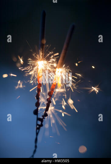 Sparkler burning and glowing in the dark - Stock Image