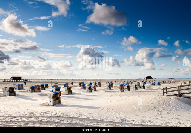 Beach chairs on the beach, St. Peter Ording, Eiderstedt peninsula, Schleswig Holstein, Germany, Europe - Stock Image