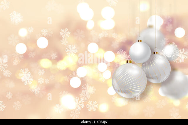 Gold Christmas background with hanging baubles - Stock Image