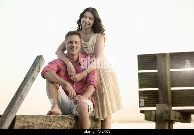 Portrait of mature couple smiling on pier, Bavaria, Germany - Stock-Bilder