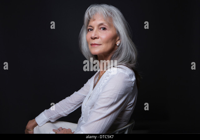 Studio portrait of aloof senior woman - Stock Image