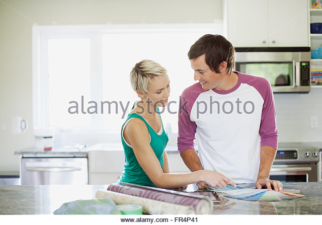 mid adult couple making decorating choices - Stock Image
