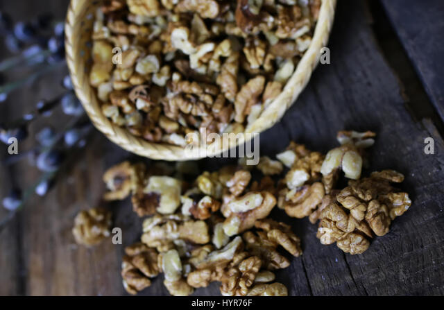 peeled walnut on a wooden background - Stock Image