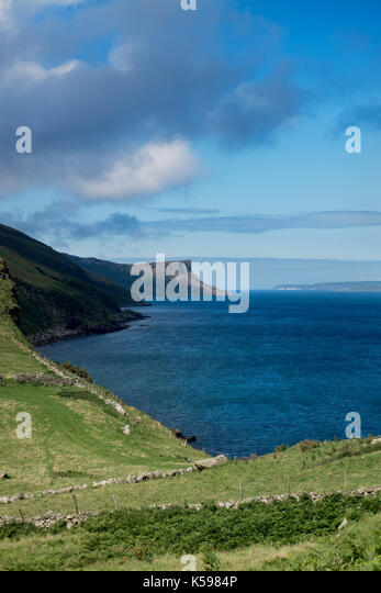 Distant view of Fair Head on the Causeway Coast in County Antrim, Northern Ireland - Stock Image