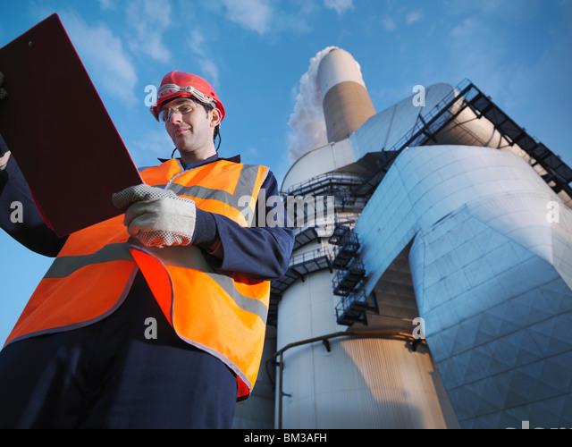 Worker & Desulphurisation Plant - Stock Image