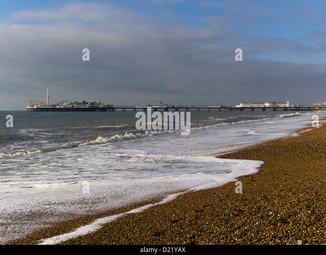 Brighton beach towards Brighton Pier, East Sussex, UK - Stock Image