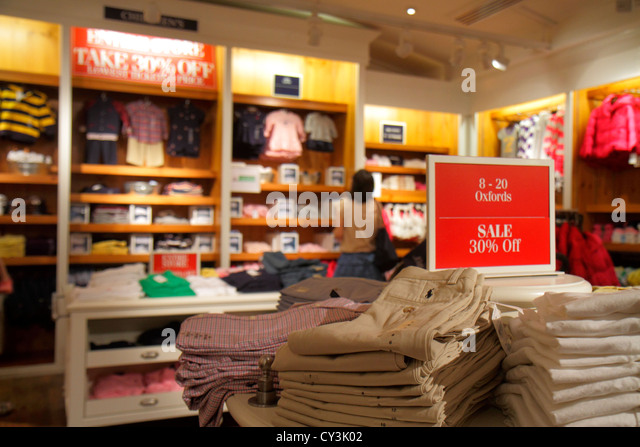 Maine Freeport Main Street Route 1 shopping Polo Ralph Lauren clothing fashion outlet retail display for sale sign - Stock Image