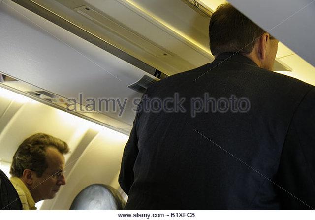 Arkansas Bentonville Northwest Arkansas Regional Airport XNA Delta Airlines man men passengers onboard - Stock Image