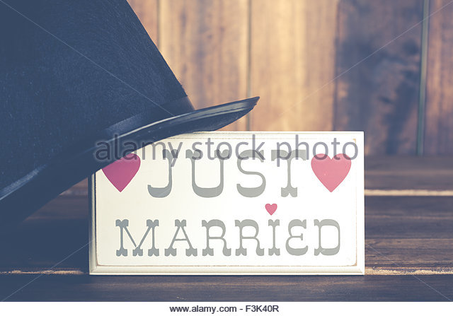 Poster newlyweds with a top hat Groom - Stock Image