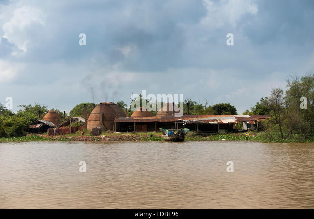 Charcoal burning in the Mekong Delta, Can Tho, Vietnam - Stock Image