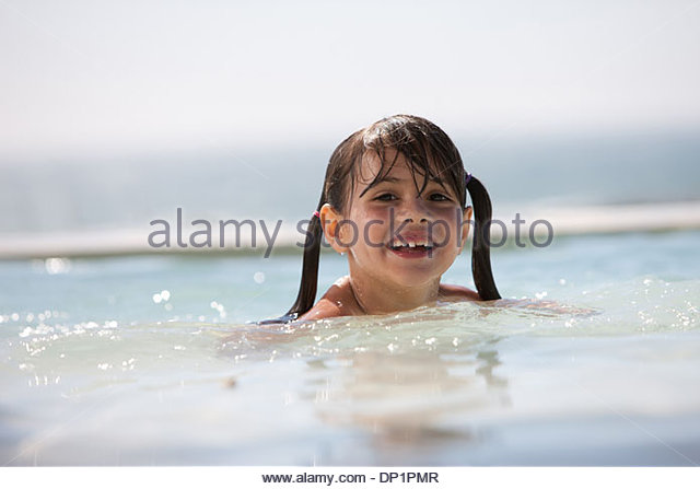 Girl in swimming pool - Stock Image
