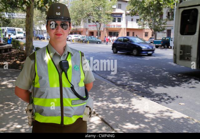 Chile Santiago Providencia Avenida Vicuna Mackenna street scene Carabiniers Carabineros de Chile national police - Stock Image