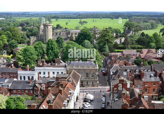 View of part of Warwick town centre, with Church Street in the foreground and Warwick Castle beyond. - Stock Image