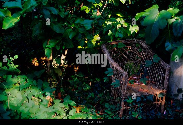 Wicker chair in a garden.Deia . Majorca .Balearic Islands.Spain - Stock Image