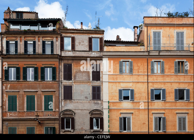 Urban apartment buildings and blue sky - Stock Image