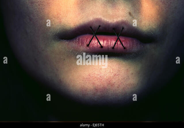 stitched lips, stitches, abuse, domestic abuse, bullying, lips, face, violence, haunting, fears, dark - Stock Image