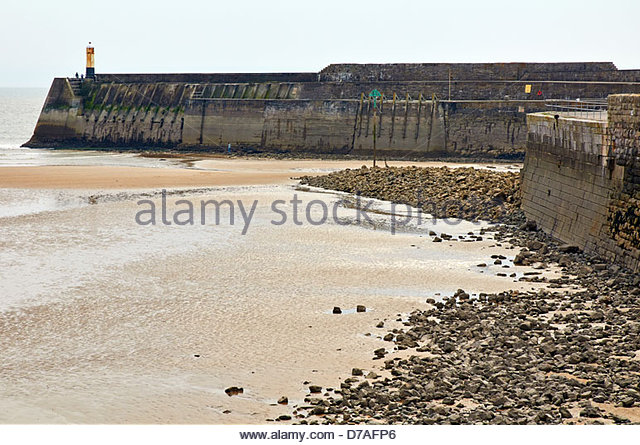 porthcawl lighthouse and breakwater with tide out - Stock Image