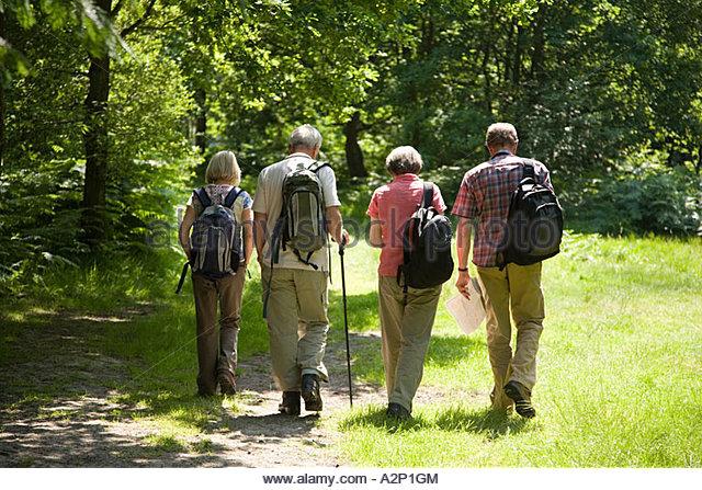 Ramblers walking in countryside - Stock Image