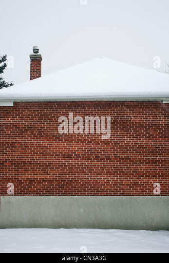 Snow on a house - Stock Image