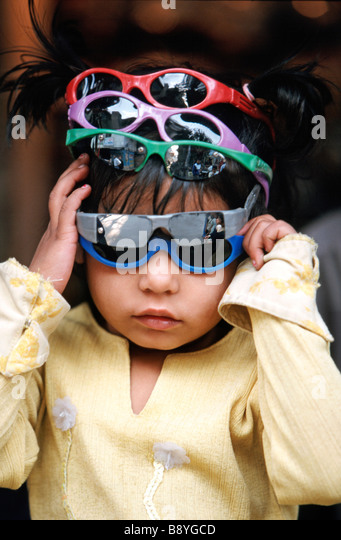 young boy with many sunglasses, India - Stock-Bilder