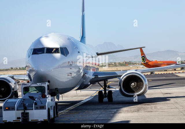 Cape Town South Africa African International Airport CPT tarmac apron runway commercial airliner plane - Stock Image