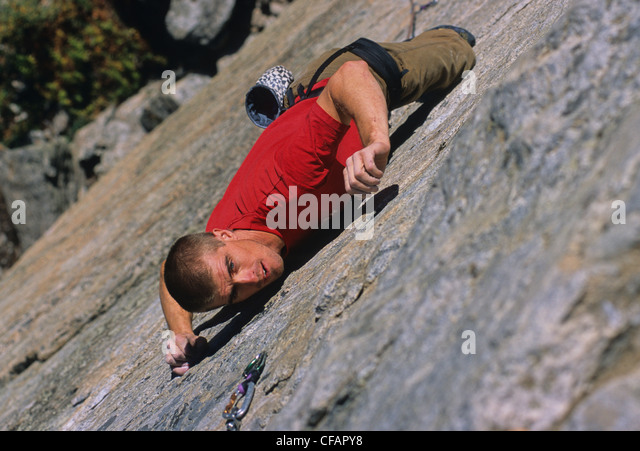 Rock climber, Doug Orr, climbing Naturopath 5.11b on The Doctor's Wall, Skaha Bluffs, Penticton, British Columbia, - Stock Image