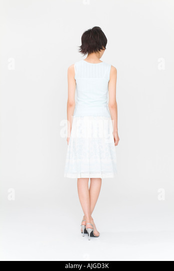 Young woman standing, rear view - Stock Image