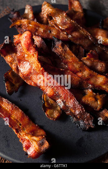Greasy Hot Grilled Bacon Ready to Eat - Stock Image