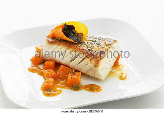Fried zander on pumpkin goulash - Stock Image