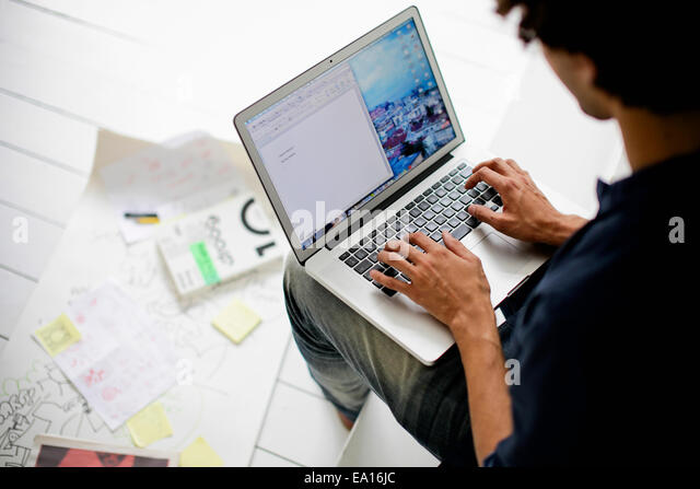 Graphic designer using laptop - Stock-Bilder