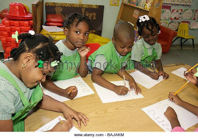 Miami Florida Little Haiti Yvonne Learning Center private Christian school education class student Black boy girl - Stock Image